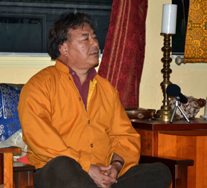 Geshe  Teaching from chair